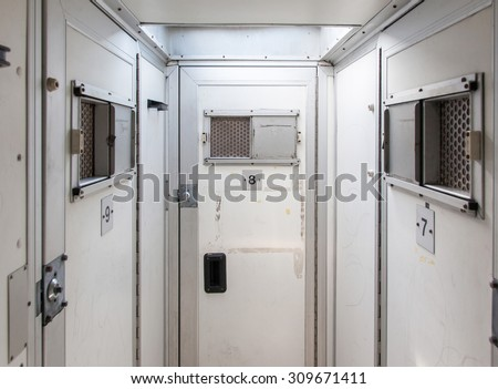 Inside of a large bus used by police to transport prisoners for public safety - stock photo