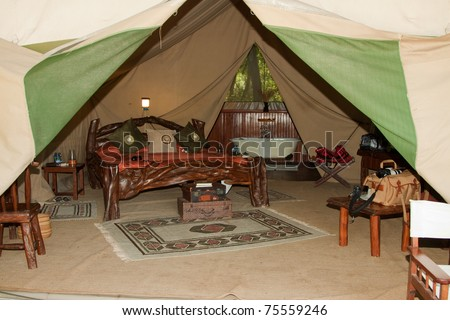Inside of a luxury safari tent at Governor's Camp in the Masai Mara - stock photo