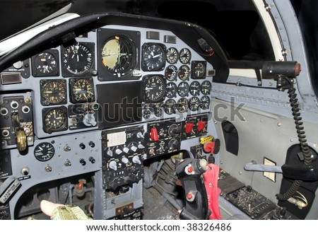 Inside of a modern military jetfighter cockpit control panel. - stock photo
