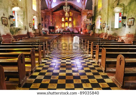 Inside of a very old catholic church - stock photo