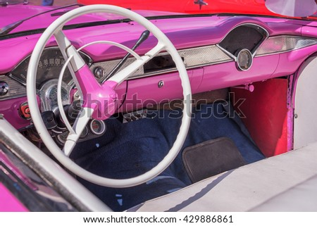 Inside of a vintage pink classic american car in Cuba - stock photo