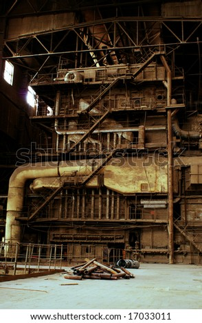 inside of abandoned old rusty industrial plant - stock photo