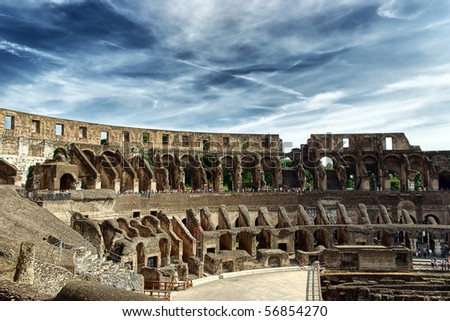 Inside of Colosseum and dramatic sky -  hdr - stock photo