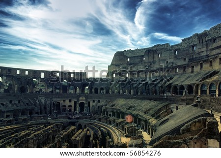 Inside of Colosseum and dramatic sky hdr - stock photo