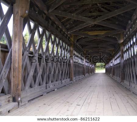inside of covered wooden bridge built in 1893 - stock photo