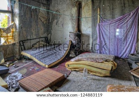 Inside of derelict house squatted by Romanies - stock photo