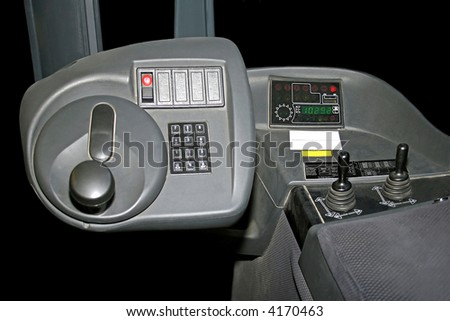 Inside of fork lifter cabin with commands - stock photo