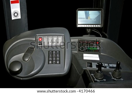 Inside of fork lifter cabin with monitor - stock photo
