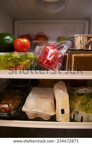 Inside Of Fridge Filled With Food - stock photo