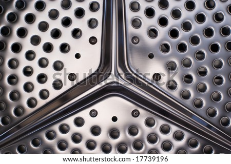 Inside of stainless steel washing trommel. - stock photo