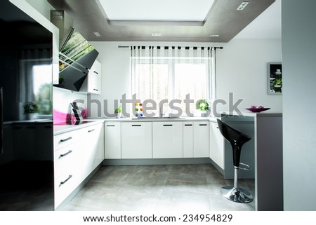 Inside of the expensive stylish open kitchen - stock photo
