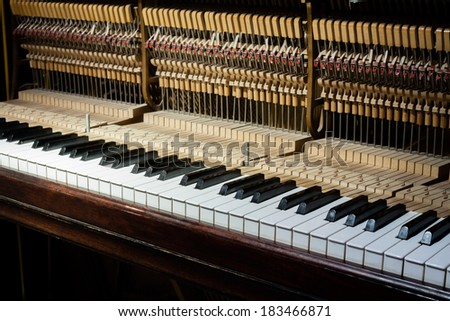 Inside of the piano - stock photo