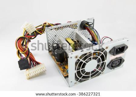 Inside of used power supply unit (PSU) on white background. - stock photo
