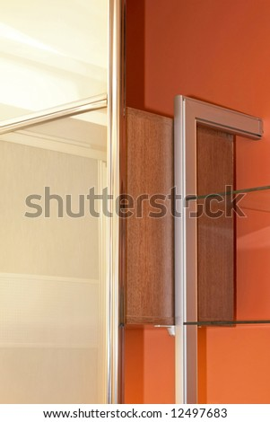 Inside of wardrobe closet with shelf detail