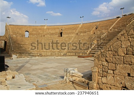 Inside the Amphitheater ruins in Caesarea Maritima National Park, a city and harbor built by Herod the Great about 25-13 BC. The archaeological ruins are on the Mediterranean coast of Israel. - stock photo