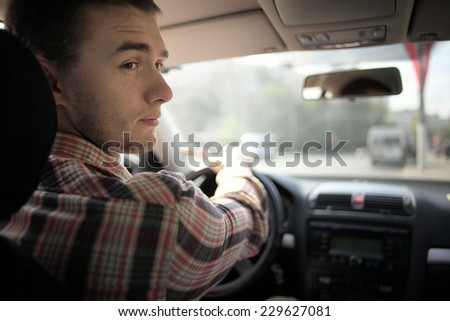 inside the car driver driving on the road - stock photo