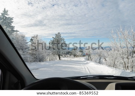 inside the car on snowy road - stock photo