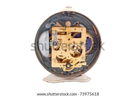 Inside the clock (watchwork), antique vintage alarm clock mechanism - stock photo