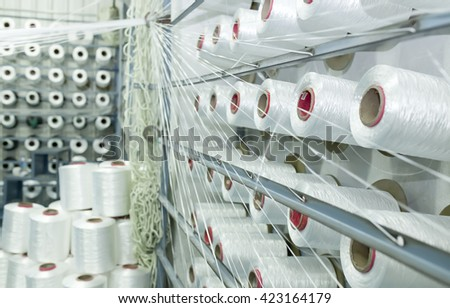 Inside the cotton mill - stock photo