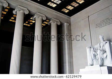 Inside the Lincoln Memorial, showing great columns and the statue of Abraham Lincoln, in Washington DC. - stock photo
