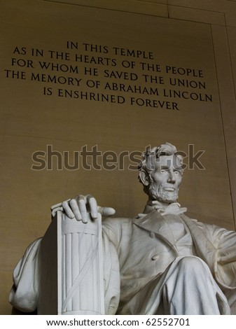 Inside the Lincoln Memorial with engraving behind Lincoln. - stock photo