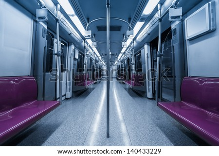 inside the subway cars,empty purple seat - stock photo