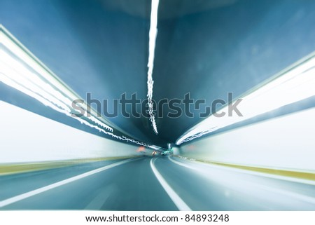 inside the tunnel with forward arrow sign and blurred speed motion - stock photo
