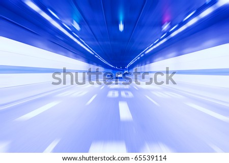 inside the tunnel with the light traces, abstract blurred speed motion - stock photo
