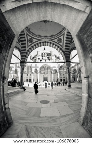 Inside the walls of a traditional Turkish Mosque, wide fish-eye view vertical picture - stock photo