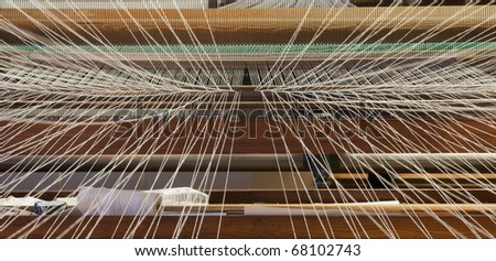 Inside the weaving machine, with the threads converging towards the inner of the machine - stock photo