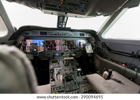 Inside view Cockpit Airplane Aircraft with blue sky and clouds - stock photo