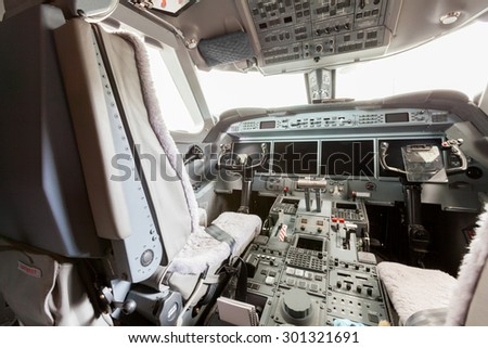 Inside view Cockpit with blue sky and clouds