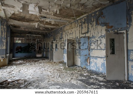 inside view of a deserted run down building - stock photo