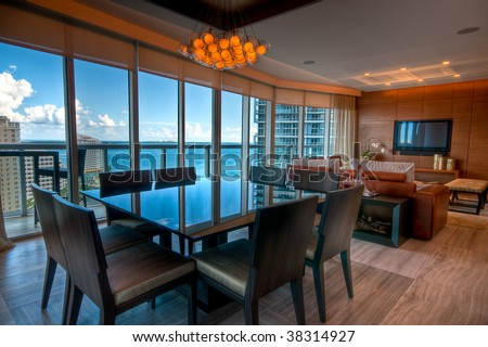 Inside view of a modern apartment with view to the bay. - stock photo