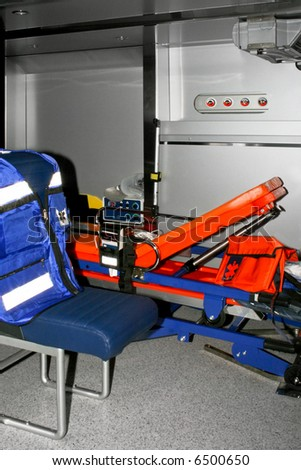 Inside view of ambulance vehicle with bed and equipment - stock photo