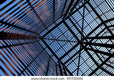 Inside view of large, interesting, industrial structure made out of metal pylons - stock photo