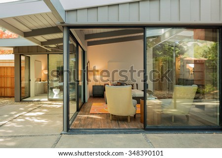 Inside view of Master Bedroom in Luxury Home with large glass sliding doors. - stock photo