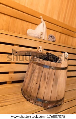 Inside view of traditional sauna with some equipment - stock photo