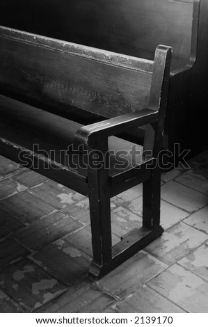 Inside view of vintage mission church pews - stock photo