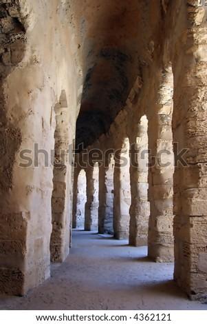 Inside walkways of the Roman Coliseum of Thysdrus at El Jem, Tunisia - stock photo