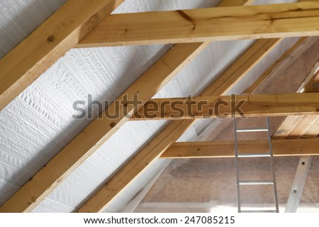 Inside wall insulation in wooden house,  building under construction  - stock photo