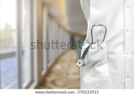 inside window background and closeup of blue and silver stetoscope  - stock photo