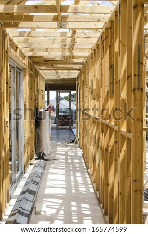 Inside wooden frame of a house under construction  - stock photo