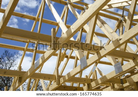 Inside wooden frame of a house under construction