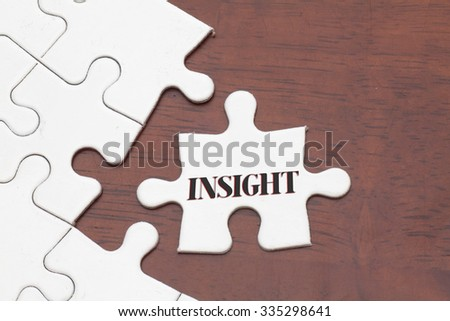 Insight word on Jigsaw Puzzle with Missing Pieces - stock photo