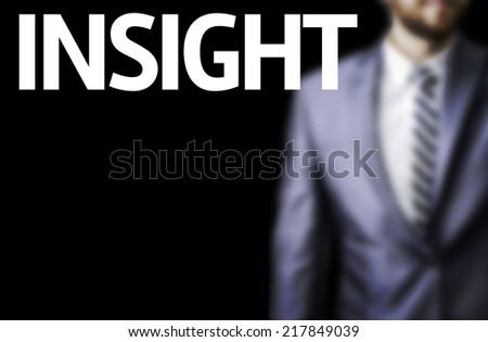 Insight written on a board with a business man on background - stock photo