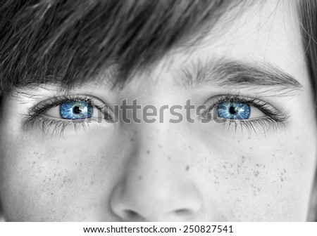 insightful look blue eyes boy - stock photo