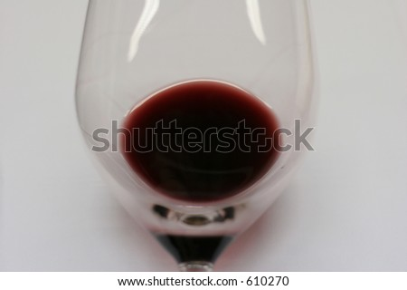 Inspecting red wine during a wine tasting event