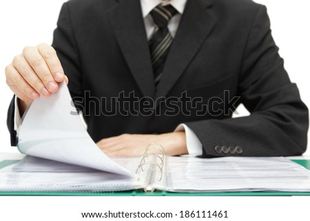 Inspection. Businessman reading binder with accounts - stock photo