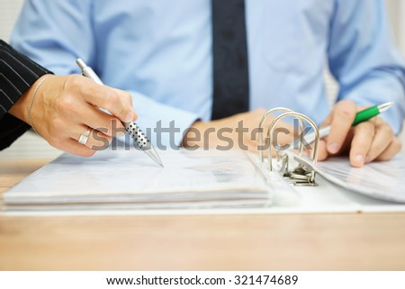Inspector find fraud in company documentation - stock photo